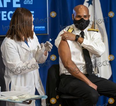 Photo - US Surgeon General Jerome M Adams MD MPH Receives Pfizer Covid-19 Vaccination
