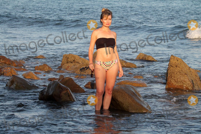 Photo - Showgirls Actress Rena Riffel shows of her fit body in Malibu