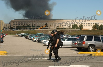 ARMED POLICE Photo - Washington DC - September 11 2001 -- Heavily armed police patrol the parking lot around the Pentagon following the terrorist attack on Tuesday September 11 2001Credit Ron Sachs  CNP