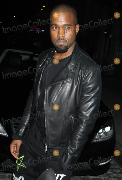 Photo - Photo by KGC-146starmaxinccomSTAR MAX2012ALL RIGHTS RESERVEDTelephoneFax (212) 995-1196102412Kanye West at a cocktail party at the Versace Boutique(NYC)US syndication only