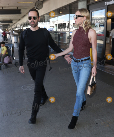 Photos From Michael Polish and Kate Bosworth are seen at LAX Airport.