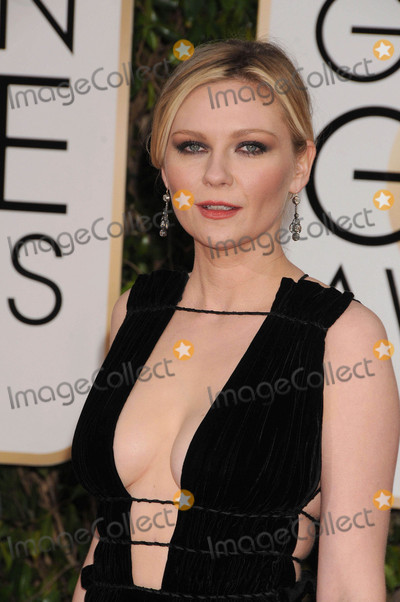 Photo - Photo by GalaxystarmaxinccomSTAR MAX2016ALL RIGHTS RESERVEDTelephoneFax (212) 995-119611016Kirsten Dunst at The 73rd Annual Golden Globe Awards(Los Angeles CA)