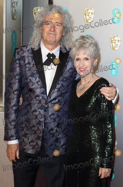 Anita Dobson Photo - London UK Brian May and Anita Dobson  at EE British Academy Film Awards at the Royal Albert Hall Kensington London on Sunday February 10th 2019Ref LMK73-J4345-110219Keith MayhewLandmark Media WWWLMKMEDIACOM