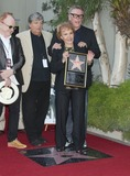Phil Everly Photo - 07 September 2011 - Hollywood California - Peter Asher Phil Everly and Gary Busey and Maria Elena Holly Buddy Holly posthumous STAR Induction into The Hollywood Walk of Fame on his 75th Birthday held in front of the Capital Records Building on Vine Street Photo Credit Russ ElliotAdMedia