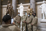 The National Photo - Members of the National Guard take photos next to the statue of Rosa Parks in Statuary Hall of the US Capitol as the House of Representatives vote on H Res 24 Impeaching Donald John Trump President of the United States for high crimes and misdemeanors at the US Capitol in Washington DC Wednesday January 13 2021 Credit Rod Lamkey  CNPAdMedia