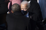 Barack Obama Photo - UNITED STATES - January 20 Former President Barack Obama hugs President Joe Biden as he departs from the inaugural stage at the end of the ceremony after being sworn in as the 46th President of the United States by Supreme Court Chief Justice John Roberts on the West Front of the Capitol on Wednesday Jan 20 2021 (Photo by Caroline BrehmanCQ Roll Call)AdMedia