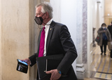 Alabama Photo - UNITED STATES - FEBRUARY 12 United States Senator Tommy Tuberville (Republican of Alabama)holds his phone as he leaves the Capitol after the the impeachment trial session in the Senate on Friday Feb 12 2021 (Photo By Bill ClarkCQ Roll Call)Credit Bill Clark  Pool via CNPAdMedia