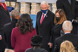Barack Obama Photo - Outgoing US Vice President Mike Pence (C) and US Second Lady Karen Pence meet Former US President Barack Obama (L) and Former US First Lady Michelle Obama (2nd L) before US President-elect Joe Biden is sworn in as the 46th US President on January 20 2021 at the US Capitol in Washington DC - Biden a 78-year-old former vice president and longtime senator takes the oath of office at noon (1700 GMT) on the US Capitols western front the very spot where pro-Trump rioters clashed with police two weeks ago before storming Congress in a deadly insurrection (Photo by Saul LOEB  POOL  AFP)AdMedia