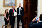 Fuel Photo - United States President Donald J Trump presents an award to Libby Bish and Rafael Melo co-founders of Frontline Fuel during a ceremony at the White House in Washington DC honoring volunteers helping others deal with coronavirus on Friday May 1 2020Credit Erin Schaff  Pool via CNPAdMedia