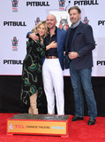 TCL Chinese Theatre Photo - 14 December 2018 - Hollywood California - Ellen K Pitbull John Travolta Pitbull Hand And Footprint Ceremonyheld at TCL Chinese Theatre Photo Credit Birdie ThompsonAdMedia