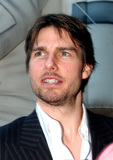 Tom Cruise Photo - Tom Cruise narrator of the new film Imax Space Station 3D arrives at the National Air and Space Museum for the premiere of the movie in Washington DC on April 17 2002Credit Ron Sachs  CNPAdMedia