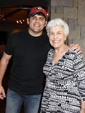 Rhett Akins Photo - August 16 2011 - Athens GA - Rhett Akins with Athens GA Mayor Nancy Denson Country artist Colt Ford rounded up his songwriter and artist friends to hold a benefit for the family of Elmer Buddy Christian an Athens Police Officer who died in the line of duty  Prior to the show Colt and friends met fans at a VIP party  Photo credit Dan HarrAdMedia