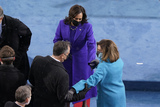Nancy Pelosi Photo - Vice President-elect Kamala Harris and her husband Doug Emhoff are greeted by House Speaker Nancy Pelosi of Calif as they arrive for the 59th Presidential Inauguration at the US Capitol in Washington Wednesday Jan 20 2021 (AP PhotoSusan Walsh Pool)AdMedia