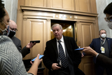 Senator Lindsey Graham Photo - Senator Lindsey Graham a Republican from South Carolina center speaks to members of the media while arriving to the US Capitol in Washington DC US on Saturday Feb 13 2021 The Senate approved 55-45 a request to consider calling witnesses in the second impeachment trial of Donald Trump a move that may extend the trial that was expected to end within hours Credit Stefani Reynolds - Pool via CNPAdMedia