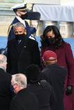 Michelle Obama Photo - Former US President Barrack Obama (L) and Michelle Obama are seen before US president-elect Joe Biden is sworn in as the 46th US President on January 20 2021 at the US Capitol in Washington DC - Biden a 78-year-old former vice president and longtime senator takes the oath of office at noon (1700 GMT) on the US Capitols western front the very spot where pro-Trump rioters clashed with police two weeks ago before storming Congress in a deadly insurrection (Photo by Saul LOEB  POOL  AFP)AdMedia