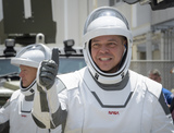 The National Photo - In this photo released by the National Aeronautics and Space Administration (NASA) NASA astronauts Robert Behnken foreground and Douglas Hurley wearing SpaceX spacesuits are seen as they depart the Neil A Armstrong Operations and Checkout Building for Launch Complex 39A to board the SpaceX Crew Dragon spacecraft for the Demo-2 mission launch Saturday May 30 2020 at NASAs Kennedy Space Center in Florida NASAs SpaceX Demo-2 mission is the first launch with astronauts of the SpaceX Crew Dragon spacecraft and Falcon 9 rocket to the International Space Station as part of the agencys Commercial Crew Program The test flight serves as an end-to-end demonstration of SpaceXs crew transportation system Behnken and Hurley are scheduled to launch at 322 pm EDT on Saturday May 30 from Launch Complex 39A at the Kennedy Space Center A new era of human spaceflight is set to begin as American astronauts once again launch on an American rocket from American soil to low-Earth orbit for the first time since the conclusion of the Space Shuttle Program in 2011 Mandatory Credit Bill Ingalls  NASA via CNPAdMedia