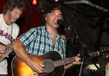 Pete Huttlinger Photo - July 26 2011 - Nashville TN - John Oates of Hall  Oates with Sam Bush backing him up Artists musicians and songwriters came together at Mercy Lounge to help raise funds for Pete Huttlinger a widely respected guitarist and Nashville studio artist  Huttlinger has a congenital heart disease and is in need of a heart transplant Photo credit Dan HarrAdmedia