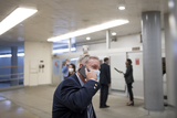 Lindsey Graham Photo - United States Senator Lindsey Graham (Republican of South Carolina) talks on a phone as he makes his way through the Senate subway following a vote at the US Capitol in Washington DC Wednesday October 21 2020 Credit Rod Lamkey  CNPAdMedia