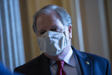 Alabama Photo - United States Senator Doug Jones (Democrat of Alabama) speaks to a reporter while leaving the Senate Floor during a vote at the United States Capitol in Washington DC US on Thursday May 14 2020  Credit Stefani Reynolds  CNPAdMedia