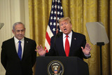 Benjamin Netanyahu Photo - United States President Donald J Trump speaks as Israels Prime Minister Benjamin Netanyahu looks on during a meeting in the East Room of the White House in Washington DCon Tuesday January 28 2020 Credit Joshua Lott  CNPAdMedia