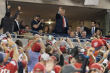 TI Photo - United States President Donald J Trump acknowledges the crowd during a moment to salute the military during game five of the World Series at Nationals Park in Washington DC on October 27 2019 The Washington Nationals and Houston Astros are tied at two games going into tonights game Credit Chris Kleponis  Pool via CNPAdMedia
