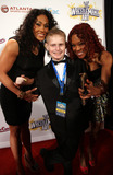 Alicia Fox Photo - March 30 2011 - Atlanta GA - WWE superstars Tamina (l) and Alicia Fox (r) with Childrens Hospital patient JJ Campobell walked the red carpet for the Wrestlemania Art Show at the Fox Theater Photo Dan HarrAdMedia