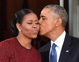 President Barack Obama Photo - President Barack Obama (R) gives Michelle Obama a kiss as they wait for President-elect Donald Trump and wife Melania at the White House before the inauguration on January 20 2017 in Washington DC  Trump becomes the 45th President of the United States Photo Credit Kevin DietschCNPAdMedia