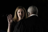 Supreme Court Photo - Associate Justice of the Supreme Court Clarence Thomas administers the oath of office to Judge Amy Coney Barrett to be Associate Justice of the Supreme Court on the South Lawn of the White House in Washington DC on Monday October 26 2020  US President Donald J Trump and her husband Jesse M Barrett look onCredit Ken Cedeno  Pool via CNPAdMedia
