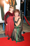 ADA-NICOLE SANGER Photo - Ada-nicole Sanger and Trisha Simmonsat the premiere of The Pursuit of Happyness Mann Village Theatre Westwood CA 12-07-06