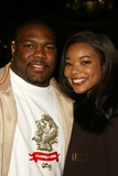 Gabrielle Union Photo - Gabrielle Union and husband at the Los Angeles Premiere of Coach Carter Chinese Theater Hollywood CA 01-13-05