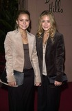 Ashley Olsen Photo - Mary-Kate and Ashley Olsen at the The Hollywood Reporters Annual Women In Entertainment Power 100 Breakfast Beverly Hills Hotel 12-03-02