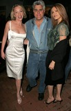 Anne-Marie Mogg Photo - Anne-Marie Mogg with Jay Leno and Jenny McShaneat a party before a Katrina Wilma and Rita Hurricane relief Auction benefitting Save the Children Automotive Legends Malibu CA 11-11-05