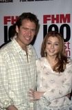 Alexis Denisof Photo - Alexis Denisof and Alyson Hannigan at FHM Magazines Sexiest Party of the Year to celebrate its annual 100 Sexiest Women in the World issue Raleigh Studios Hollywood CA 06-05-03