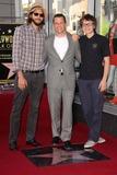 Angus T Jones Photo - Ashton Kutcher Jon Cryer Angus T Jonesat Jon Cryers induction into the Hollywood Walk of Fame Hollywood CA 09-19-11