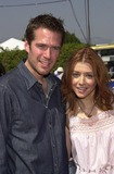 Alexis Denisof Photo - Alexis Denisof and Alyson Hannigan at the 2002 Teen Choice Awards Presented by Fox at the Universal Amphitheater Universal City CA 08-04-02