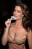 Carrie Stevens Photo - Playmate Carrie Stevens poses with the new KISS condoms at a Tongue Magazine party to celebrate the release of the second KISS condom Studded Paul Barfly West Hollywood CA 09-27-02