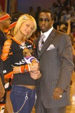 Diddy Combs Photo - Paris Hilton and Sean P Diddy Combs at the 2004 NBA All-Star Celebrity Basketball Game in the Los Angeles Convention Center Los Angeles CA 02-13-04
