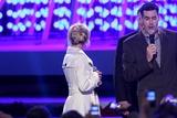 Adam Carolla Photo - Britney Spears and Adam Carolla  at the Debut of LA Lives Light of Angels LA Live Los Angeles CA 12-04-08