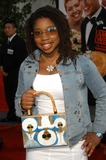 Giovonnie Samuels Photo - Giovonnie Samuels and her handbag available at wwwgbabyartwearcom at the world premiere of Universals American Wedding at Universal Studios Universal City CA 07-24-03