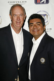 John Foster Photo - John Foster and George Lopezat the press conference announcing George Lopez as the celebrity spokesperson for the 2007 Bob Hope Chrysler Classic Warner Bros Studios Burbank CA 08-22-06