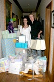 Amelia Heinle Photo - Amelia Heinle and Thad Luckinbill with thier shower giftsAmelia Heinle Luckinbill Baby ShowerHome of Melody Thomas ScottLos Angeles   CAOctober 8 2007