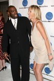 Antwone Fisher Photo - Sharon Stone and Antwone Fisher arriving at the  A Smile for Every Child Gala at the Shangri La Hotel in  Santa Monica CA on September 10 2009