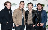 Arctic Monkeys Photo - BALA CYNWYD PA - SEPTEMBER 18  (L to R) Jamie Cook Matt Helders Alex Turner and Nick OMalley of the British Alternative Rock Band Arctic Monkeys Pose at Radio 1045s Performance Theatre on September 18 2013 in Bala Cynwyd Pennsylvania  (Photo by Paul J FroggattFamousPix)
