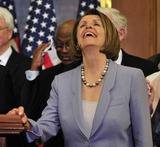 House Speaker Nancy Pelosi Photo - RESTRICTED NO NEW YORK OR NEW JERSEY NEWSPAPERS WITHIN A 75 MILE RADIUS OF NYCUnited States House Speaker Nancy Pelosi (Democrat of California) enjoys a good laugh as she and US House Democratic Leaders celebrate the passage of the health care reform bill in the US Capitol in Washington DC early Monday morning March 22 2010Photo by Ron Sachs-CNP-PHOTOlinknet