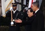 Mark Wilson Photo - WASHINGTON DC - JANUARY 19 (AFP OUT) US President Barack Obama (R) walks with Chinese President Hu Jintao during a State arrival ceremony on the South Lawn of the White House January 19 2011 in Washington DC Obama and Hu are scheduled to meet in the Oval Office later in the day hold a joint press conference and attend a State dinner Photo by  Mark WilsonPoolCNP-PHOTOlinknet
