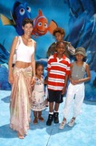 Nicole Mitchell Murphy Photo - Photo by  Tom LauLoud  Clear MediaSTAR MAX Inc - copyright 2003  ALL RIGHTS RESERVED 51803Nicole Mitchell Murphy  her kids with Eddie Murphy at the World Premiere of Finding Nemo from Pixar Animation StudiosWalt Disney Pictures(CA)