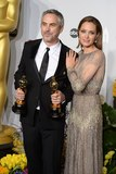 Alfonso Cuaron Photo - Photo by Doug PetersstarmaxinccomSTAR MAX2014ALL RIGHTS RESERVEDTelephoneFax (212) 995-11963214Alfonso Cuaron with his Achievement in Directing Award for Gravity alongside Angelina Jolie at the 86th Annual Academy Awards (Oscars)(Hollywood CA)