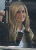 Jennifer Don Photo - Jennifer Aniston shoots scenes for her new movie Wanderlust with Paul Rudd  The pair filmed some indoor scenes where Jennifer showed off her long beautiful blonde locks and Paul took a break to eat an apple  Jennifer got her makeup touched up and appeared very happy as she smiled and clapped her hands After work Jennifer donned some trendy glasses a pea coat jeans and brown suede boots then got in to a waiting SUV  New York NY 111810