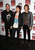 Christopher Wolstenholme Photo - Christopher Wolstenholme Dominic Howard and Matthew Bellamy at the NME Awards 2011 at Brixton Academy in London UK 22311