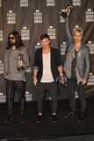 30 Seconds to Mars Photo - Jared Leto Tomo Milicevic and Shannon Leto of 30 Seconds to Mars with their awards in the pressroom at the 2010 MTV Video Music Awards held at the Nokia Theatre Los Angeles CA 091210